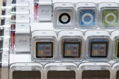 Lägga till låtar till en iPod utan att synkronisera den hela iTunes-biblioteket