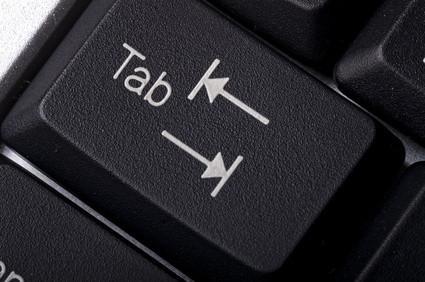 Hur man löser TAB-tangenten på en bärbar dator tangentbord